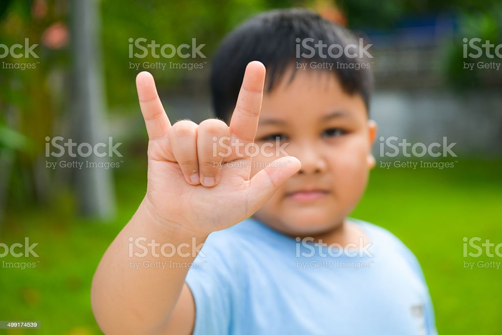 Cute boy show love symbol hand stock photo