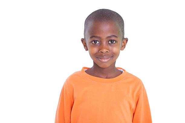 Cute boy smiling at camera stock photo