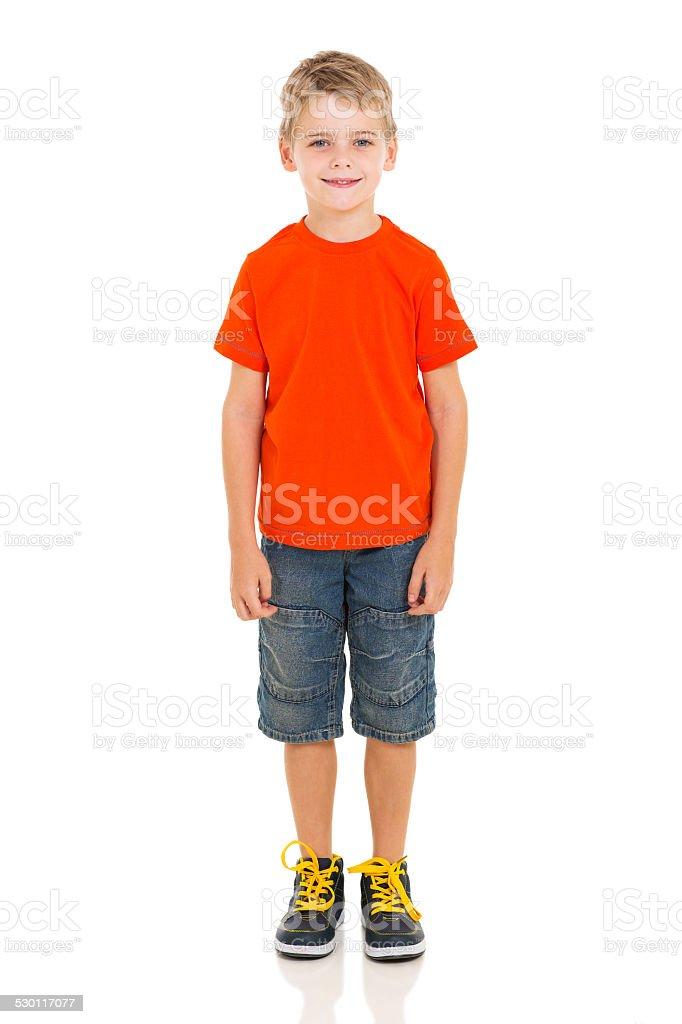 cute boy standing on white stock photo