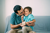 istock Cute boy surprising his father with a gift for Father's Day 1152283682