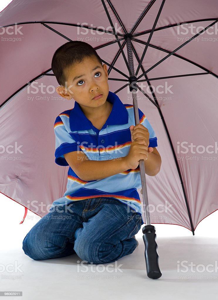 cute boy under huge umbrella royalty-free stock photo