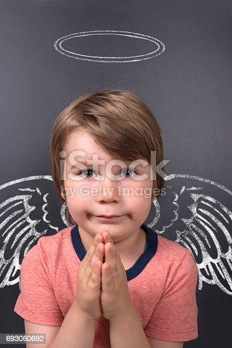 istock Cute Boy With Angel Wings And Halo 693060692
