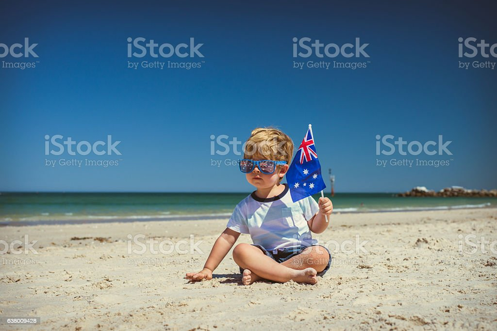 Cute boy with Australian flag on Australia day stock photo