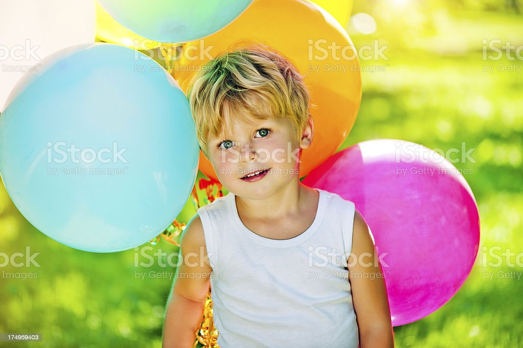 Cute boy with balloons royalty-free stock photo