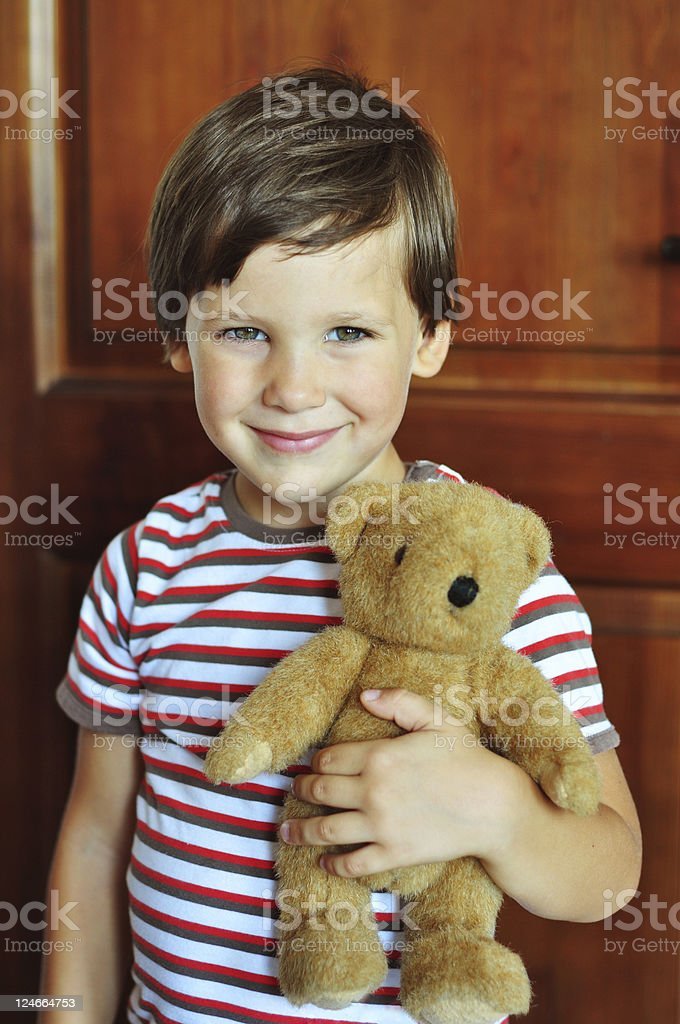 Cute boy with bear stock photo