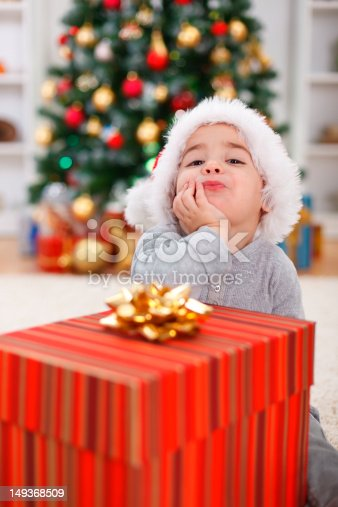 istock Cute boy with big Christmas present 149368509