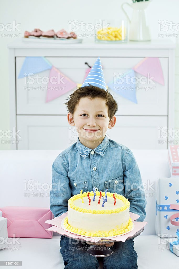 Cute boy with birthday cake royalty-free stock photo