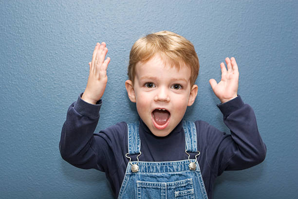 Cute Boy with Expression  bib overalls boy stock pictures, royalty-free photos & images