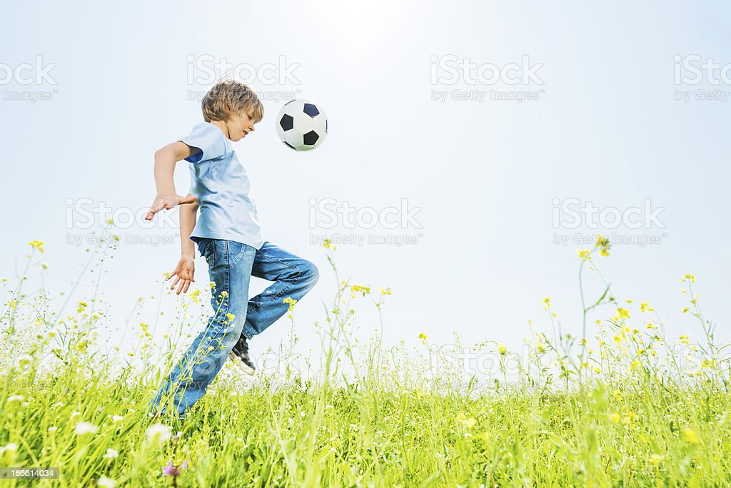 Cute boy with football outdoors. royalty-free stock photo