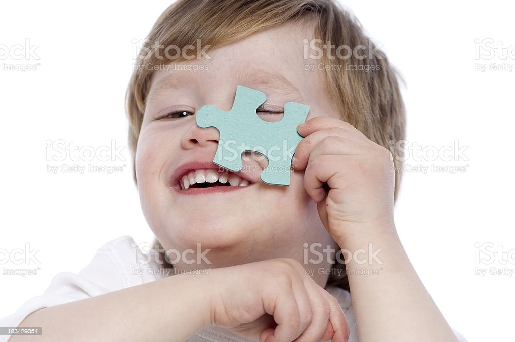 Cute boy with puzzle royalty-free stock photo
