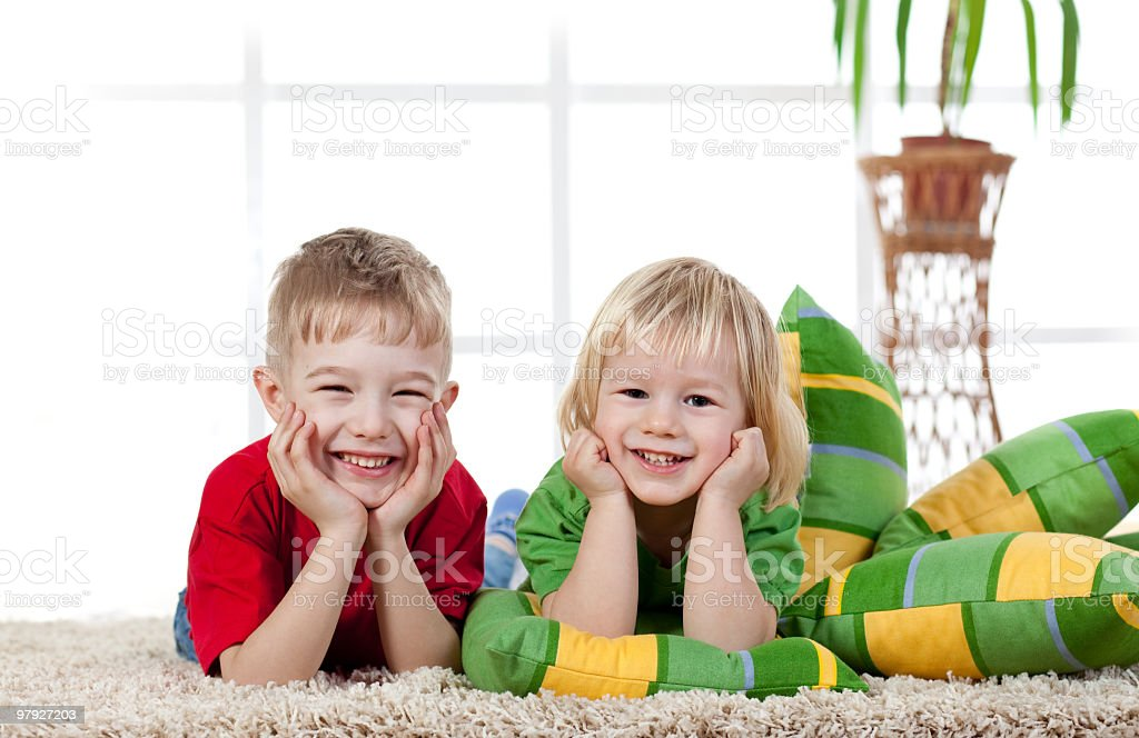 Cute boys lying on the floor and smiling royalty-free stock photo
