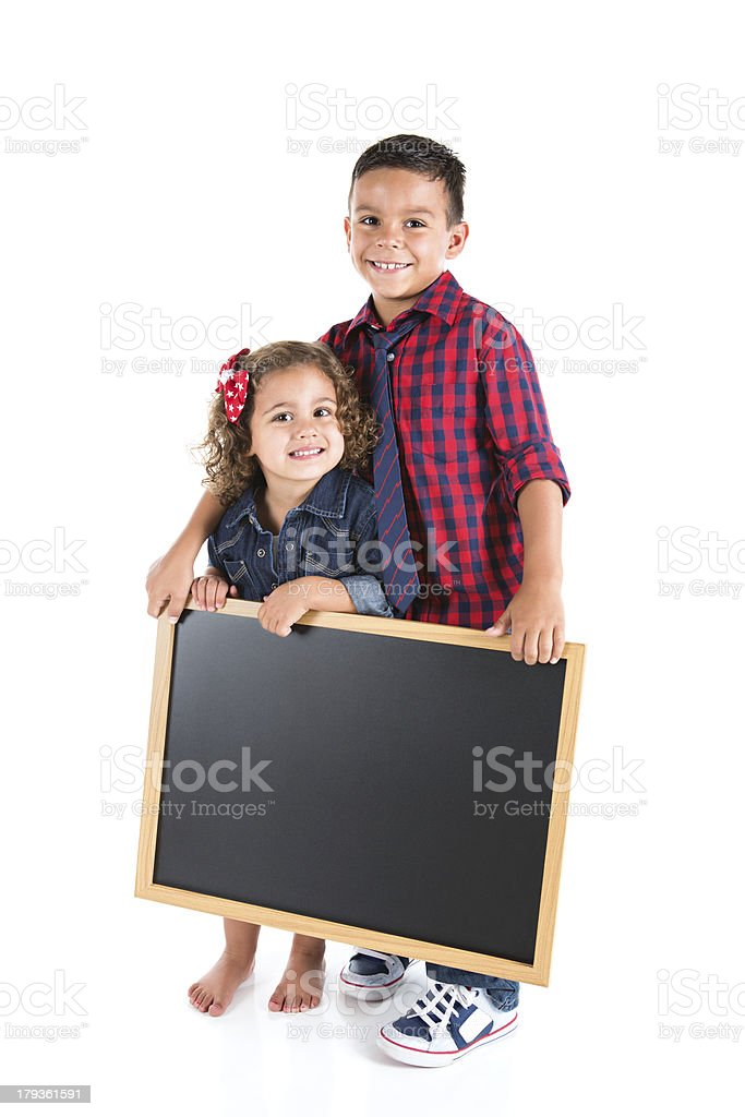 Cute Brother and Sister Holding Chalkboard Sign royalty-free stock photo