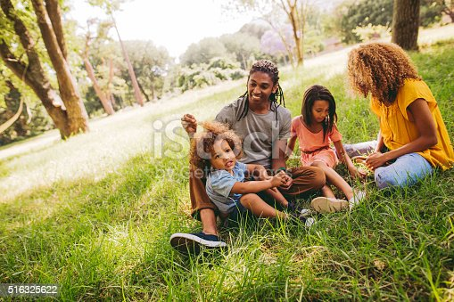 518064982 istock photo Cute brother and sister spends time with their parents. 516325622