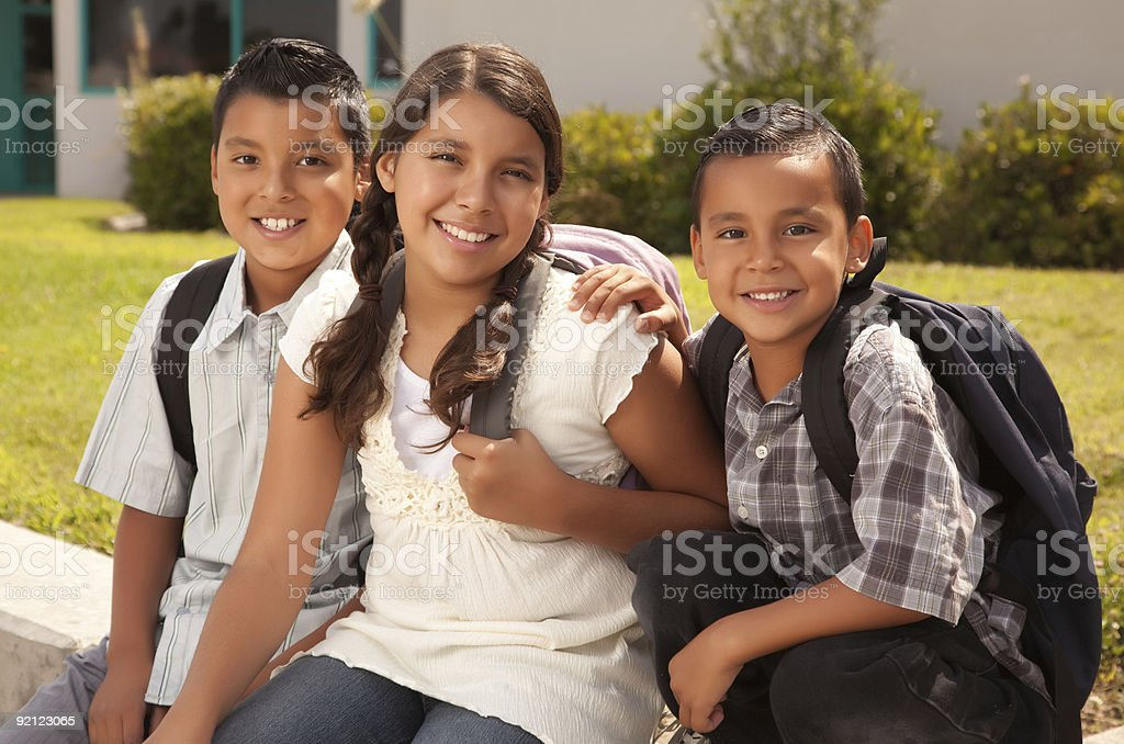 Cute Brothers and Sister Ready for School stock photo