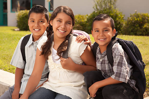 Cute Brothers and Sister Ready for School  sibling stock pictures, royalty-free photos & images