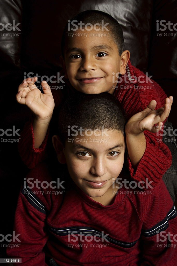 cute brothers sitting down royalty-free stock photo