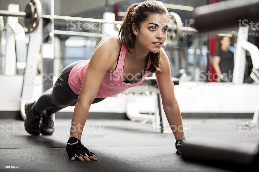 cute brunette working out at a gym stock photo & more pictures of 20