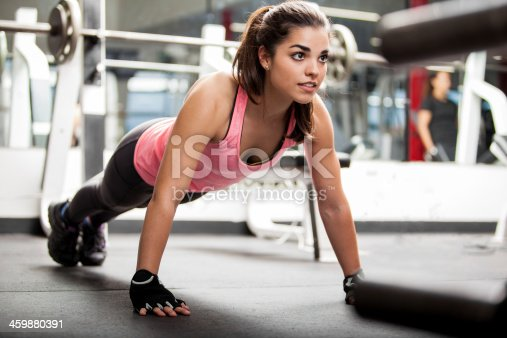 istock Cute brunette working out at a gym 459880391