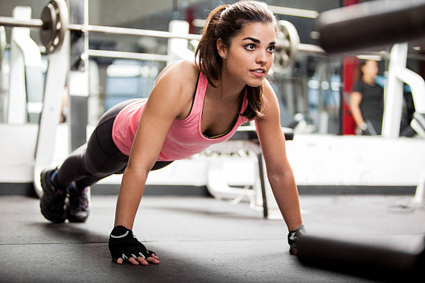 cute brunette working out at a gym - push up stock photos and pictures