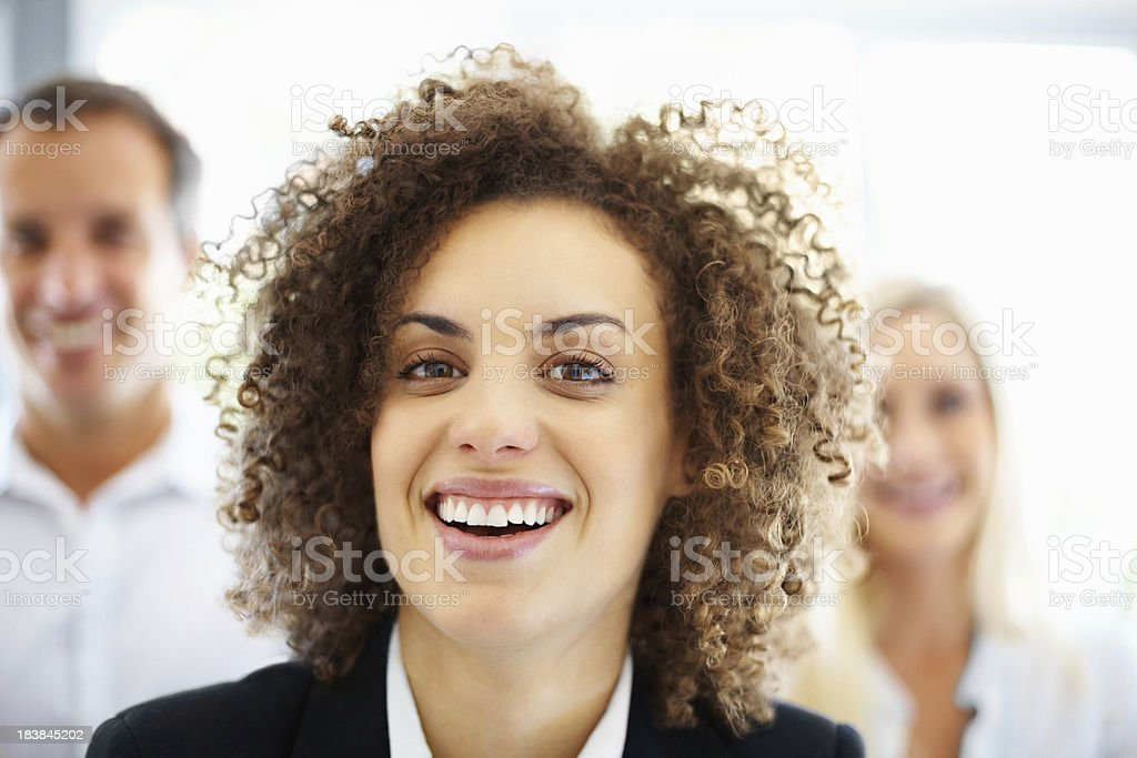 Cute business woman with colleagues in the background royalty-free stock photo