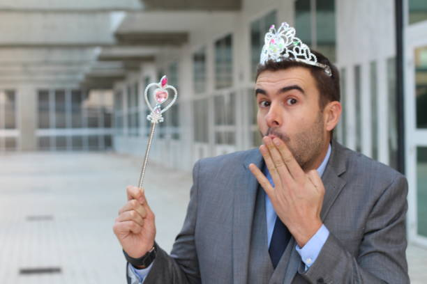 cute businessman wearing a princess crown - fairy wand stock photos and pictures