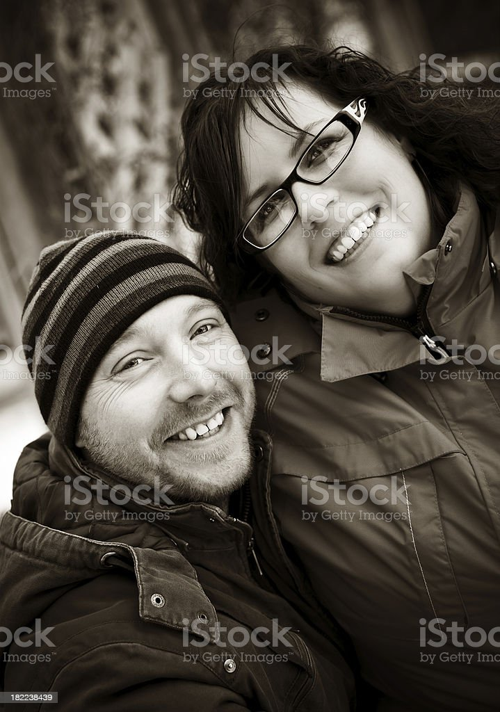 Cute candid couple - sepia toned royalty-free stock photo