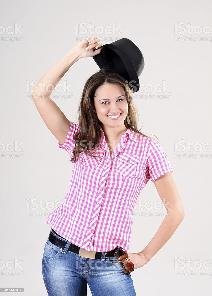 Cute caucasian young woman in plaid shirt and hat posing royalty-free stock photo