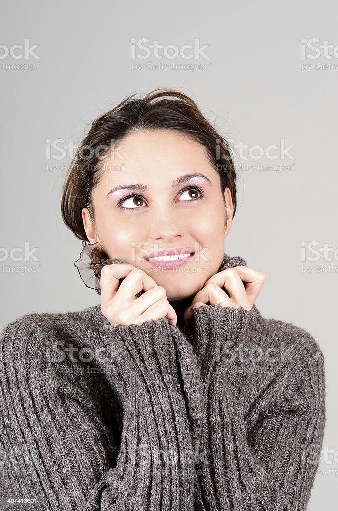 Cute caucasian young woman in winter fashion posing in studio royalty-free stock photo