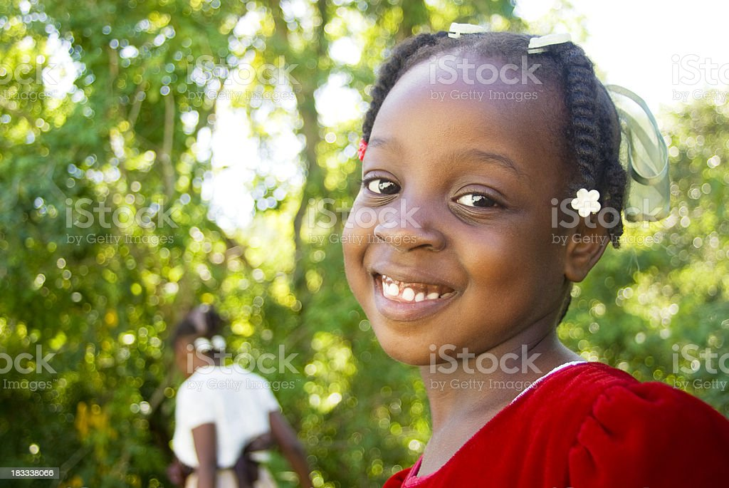 cute charming smiling girl in red dress outdoors stock photo