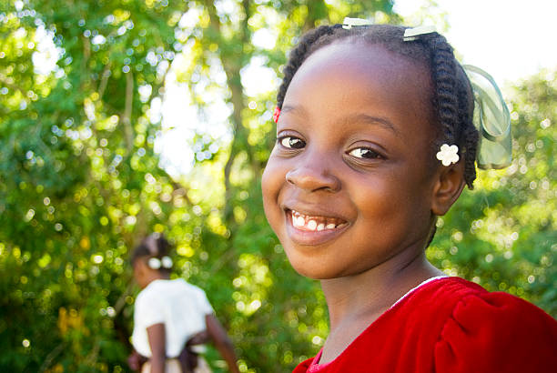 cute charming smiling girl in red dress outdoors cute charming smiling girl in red dress outdoors afro caribbean ethnicity stock pictures, royalty-free photos & images