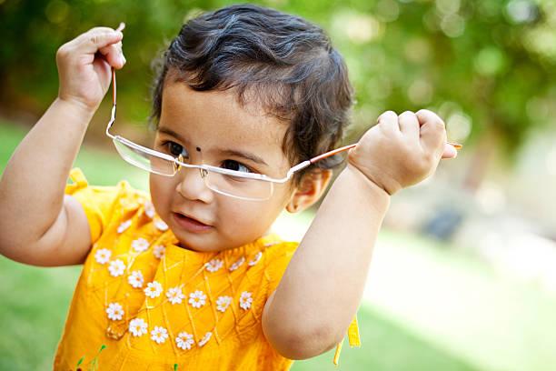 Cute cheerful indian baby girl playing with fathers glasses picture id175601748?b=1&k=6&m=175601748&s=612x612&w=0&h=rdpovlcfsqkgvbydyktvfwidzlsjqs9beybijk2g6da=