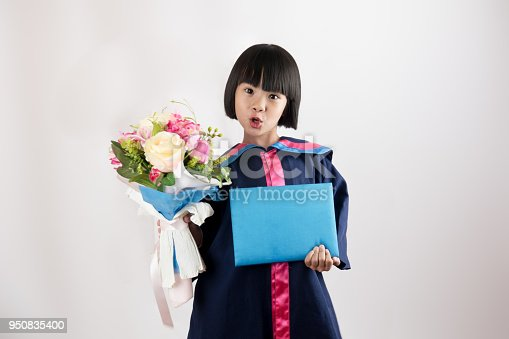istock Cute child and happy kid on kindergarten graduated dress on gray white background 950835400