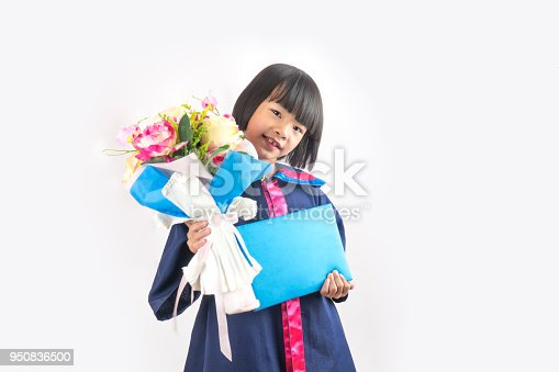 istock Cute child and happy kid on kindergarten graduated dress on gray white background 950836500