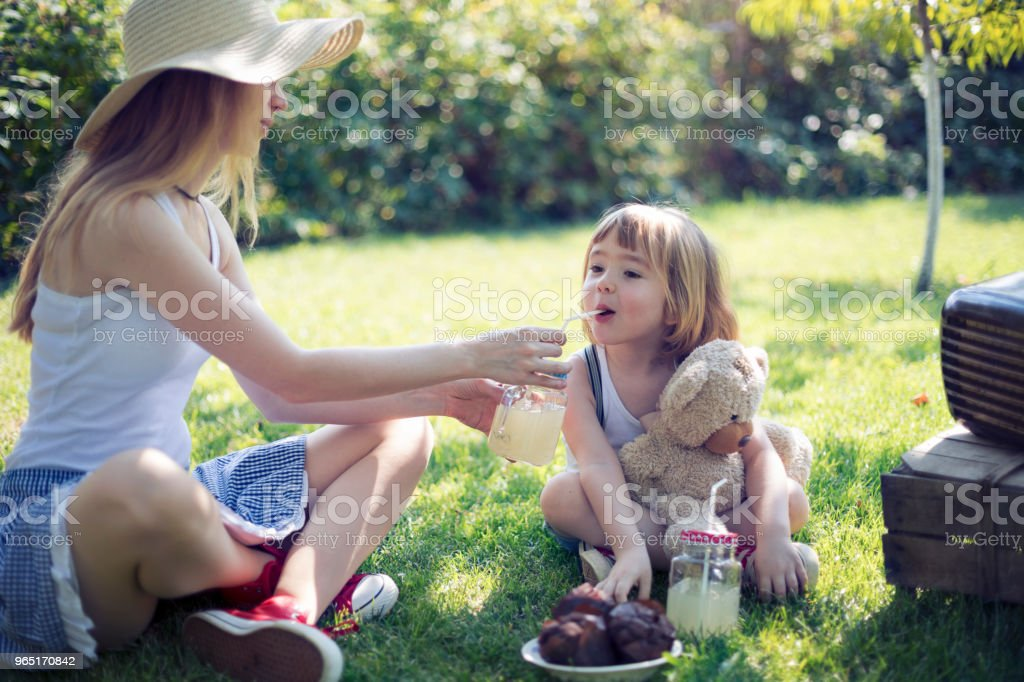Cute child and his mommy having backyard party royalty-free stock photo
