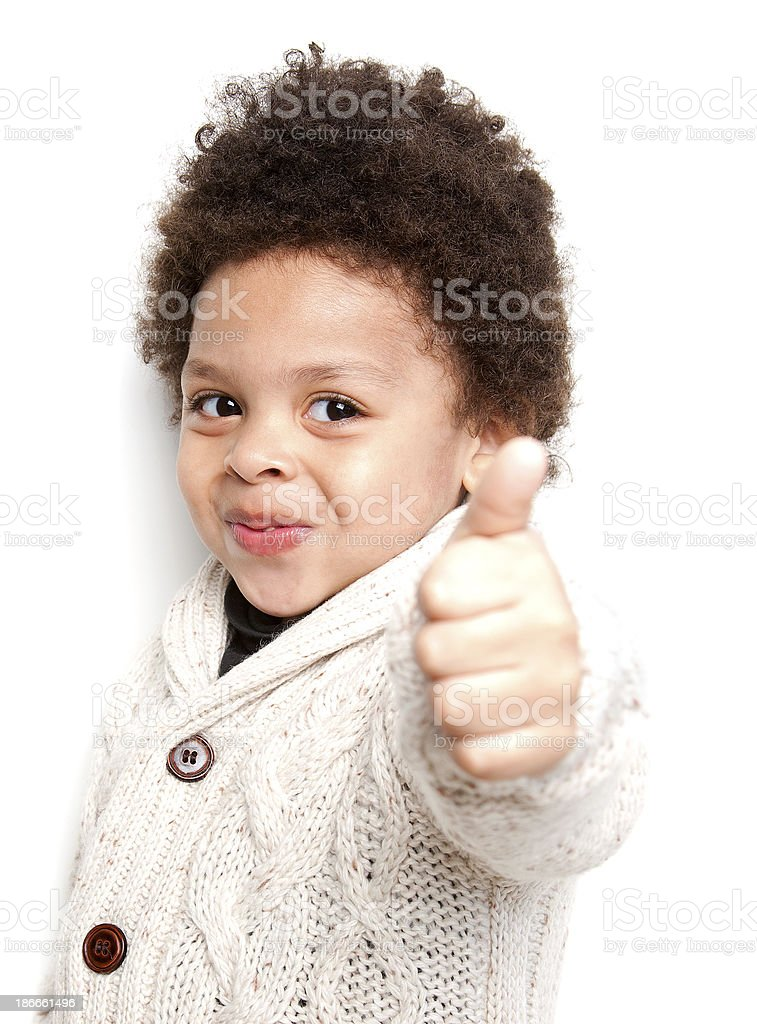 Cute child doing thumbs up sign stock photo