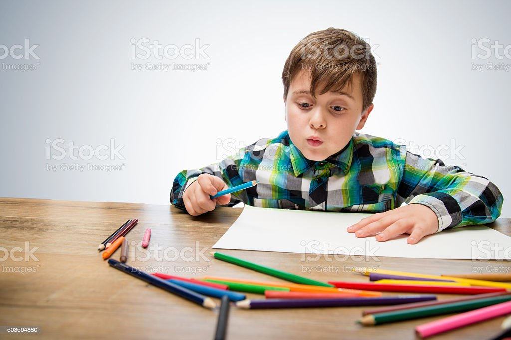 Cute Child Draw With Color Crayons Royalty Free Stock Photo