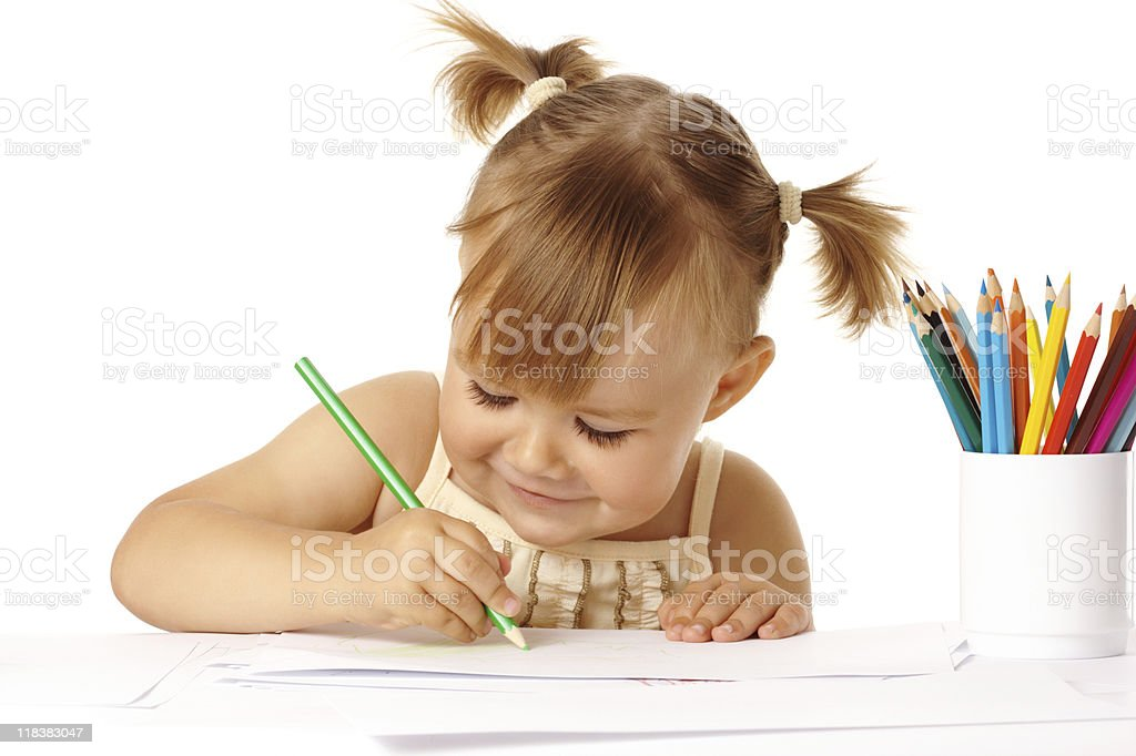 Cute child draw with color pencils and smile royalty-free stock photo