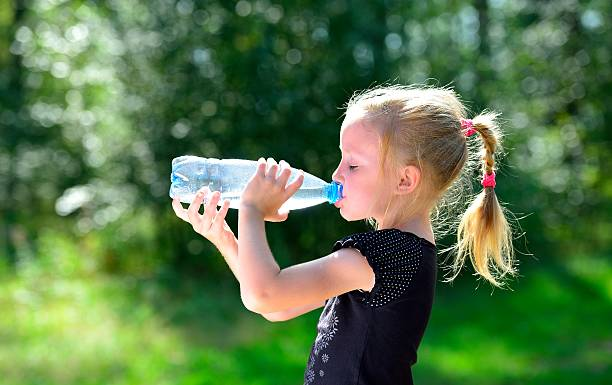 Cтоковое фото Cute child drinking water from a bottle