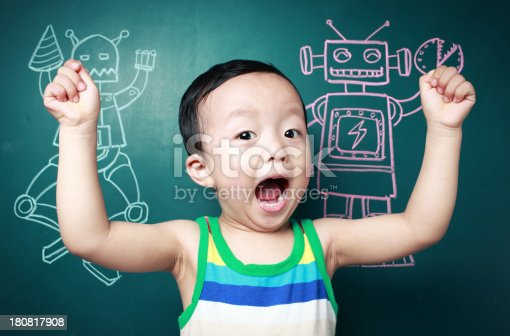 istock Cute child in front of the blackboard 180817908