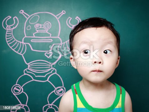 istock Cute child in front of the blackboard 180819829