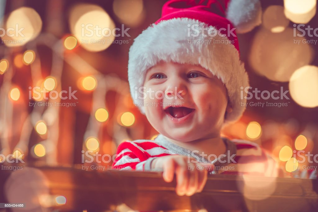 9086e971503 Cute Child In Pajamas In Christmas Stock Photo   More Pictures of ...