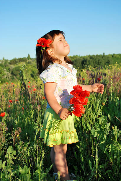 cute child looking at the sun stock photo