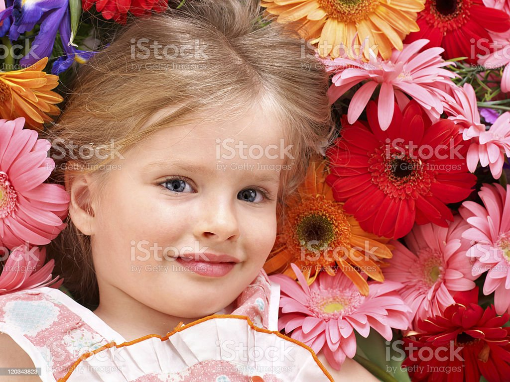 Cute child lying on the flower. royalty-free stock photo