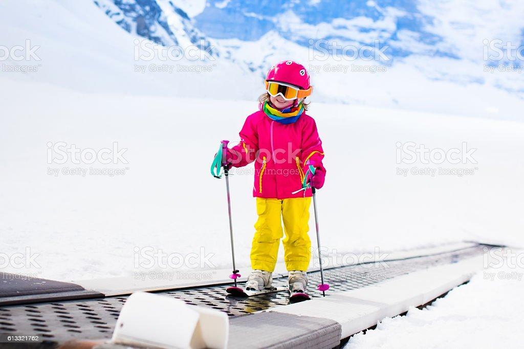 Cute child on ski lift stock photo