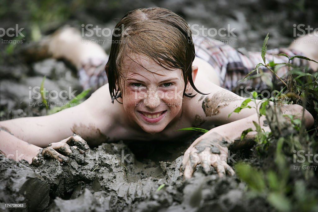 Cute Child Playing in Mud royalty-free stock photo