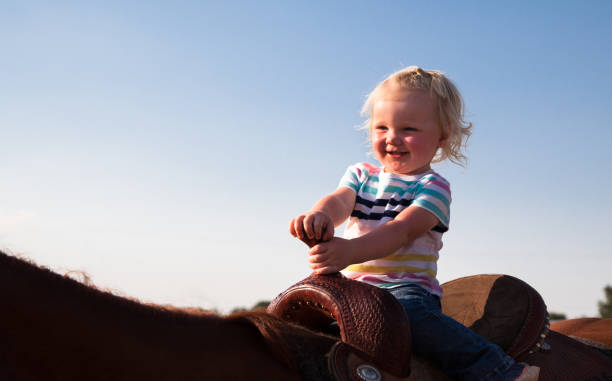 Cute child riding big horse outdoors in sunny utah evening picture id843042100?b=1&k=6&m=843042100&s=612x612&w=0&h=bpzjq bzsxpw pf6oxhmpfyftgzf zzkl2wsd9n9rnc=