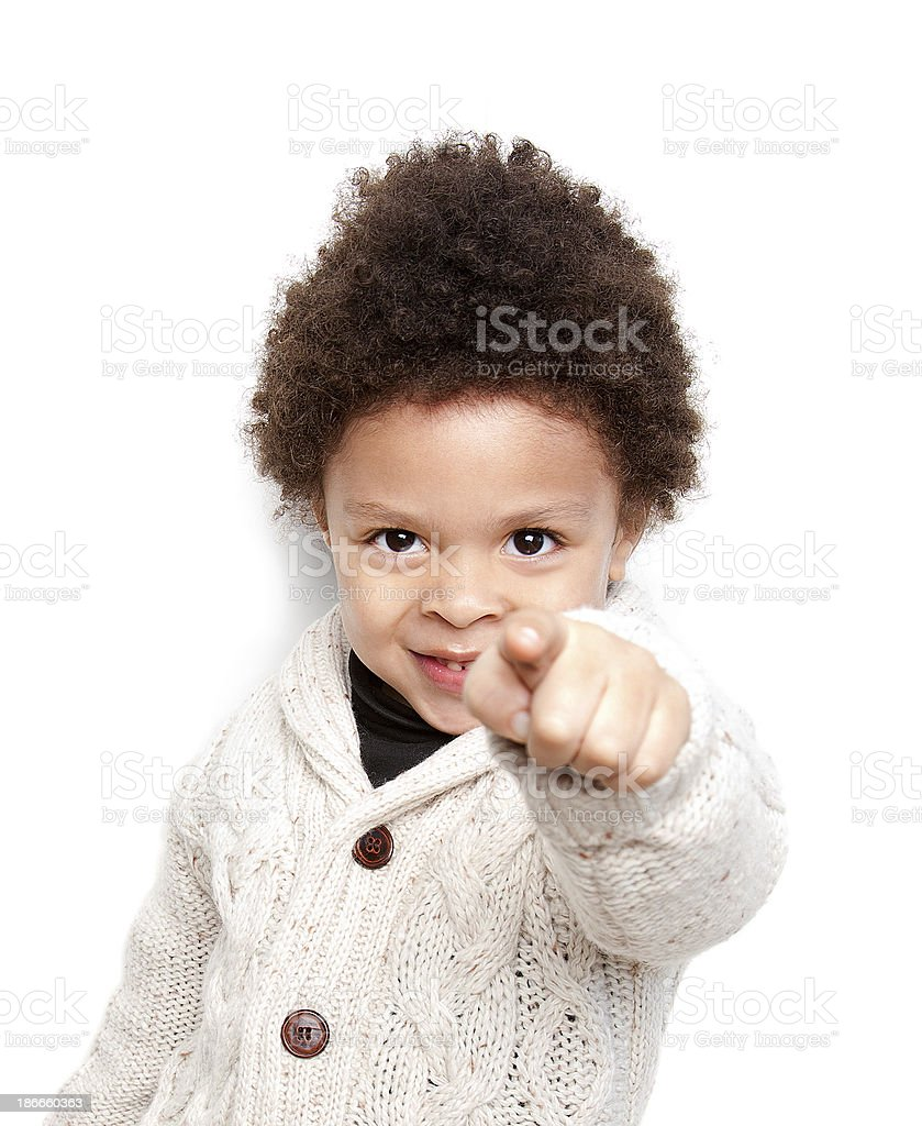 Cute child smiling and pointing at you stock photo