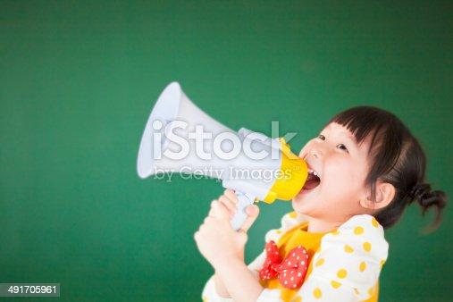 istock cute child  using a megaphone in a classroom 491705961
