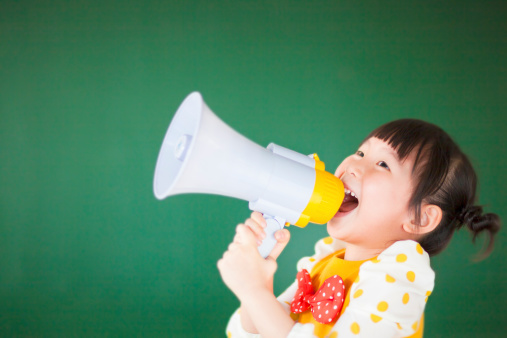 istock cute child  using a megaphone in a classroom 491705961