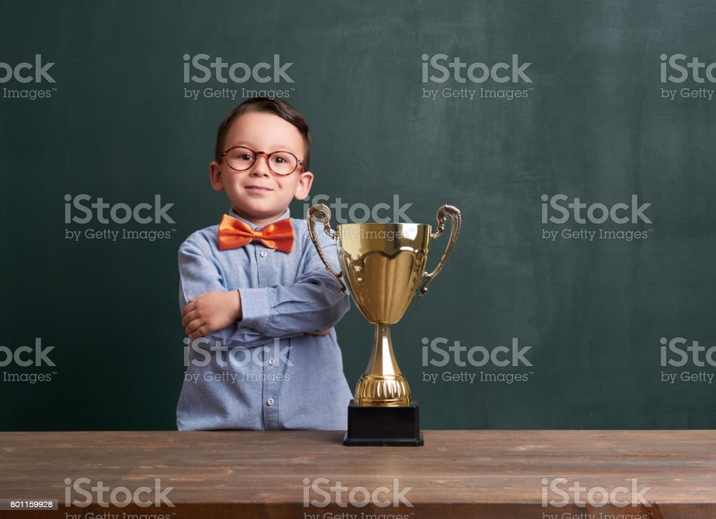 Cute child with a golden trophy stock photo